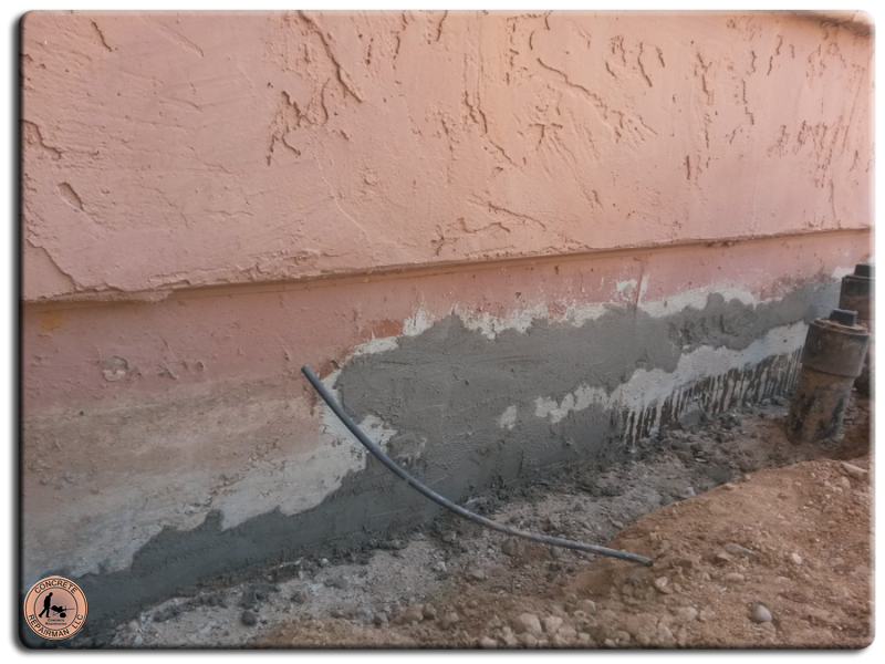 Covering the repaired area of the foundation