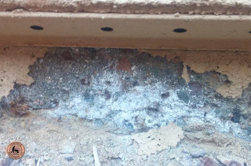Efflorescencesalt deposits are spallingthis vertical stem wall